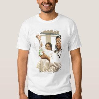 Scientist adding solution to beaker shirts