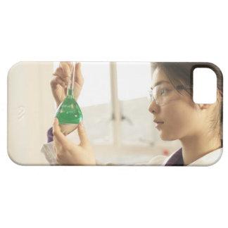 Scientist examining liquid in beaker iPhone 5 covers