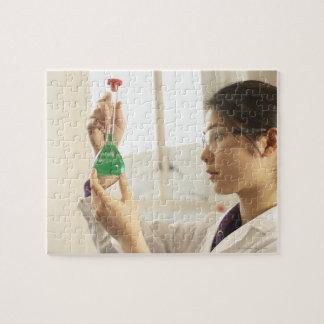 Scientist examining liquid in beaker jigsaw puzzle