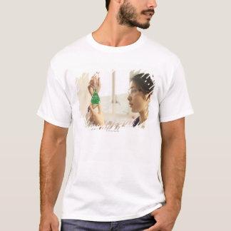 Scientist examining liquid in beaker T-Shirt