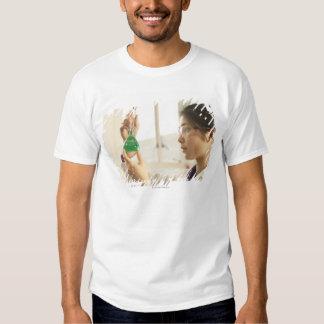 Scientist examining liquid in beaker tshirts