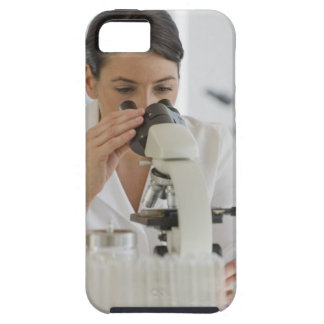 Scientist using microscope in pharmaceutical case for the iPhone 5