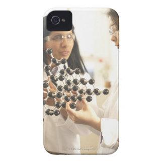 Scientists examining molecular model iPhone 4 cover
