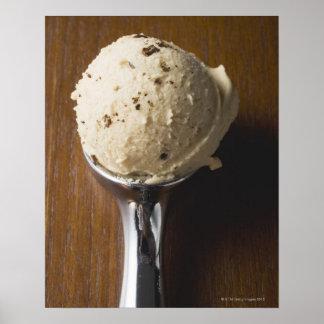 Scoop of ice cream in ice cream scoop (overhead poster