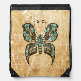 Scratched and Worn Blue Haida Spirit Butterfly Drawstring Backpacks