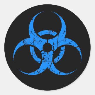 Scratched Blue Biohazard Symbol on Black Round Sticker