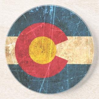 Scuffed and Worn Colorado Flag Coaster