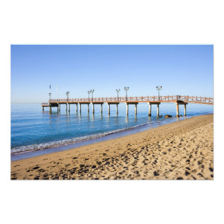 Sea, Beach and Pier on Costa del Sol in Spain Photo