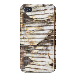 Sea breams on barbecue grill. covers for iPhone 4