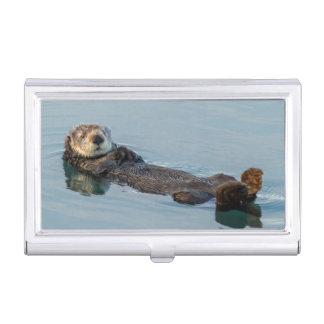 Sea otter floating on back in ocean business card holder