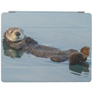 Sea otter floating on back in ocean iPad cover