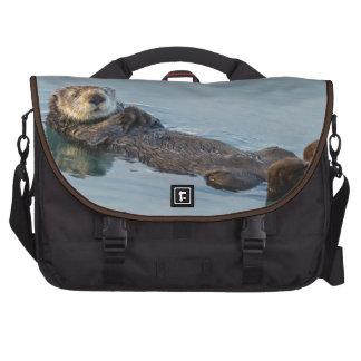 Sea otter floating on back in ocean laptop commuter bag