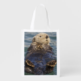 Sea otters play on icebergs at Surprise Inlet Reusable Grocery Bag