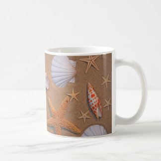 Sea Shells And Starfish Arranged On Sand Coffee Mug