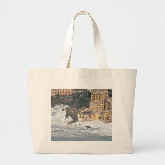 Sea storm in Camogli Tote Bags