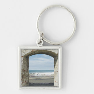 Sea viewed from an archway key ring