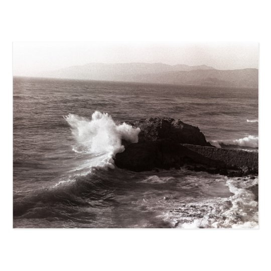 Sea waves crashing against rock postcard