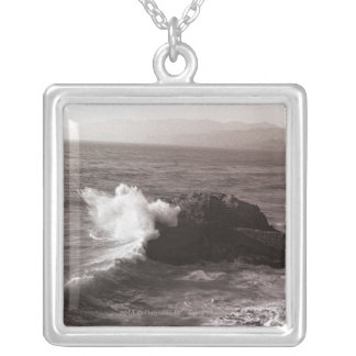Sea waves crashing against rock silver plated necklace