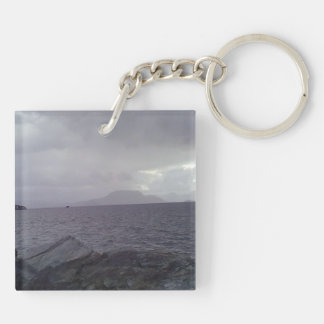 Sea with mountain in the background acrylic keychain