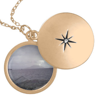 Sea with mountain in the background round locket necklace