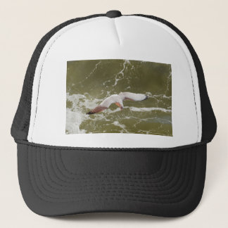 Seagull Gliding Over The Waves Trucker Hat