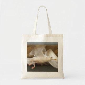 Seagull in flight tote bag