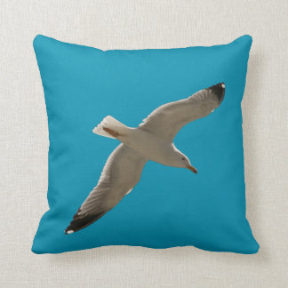 Seagull on a blue sky throw pillow