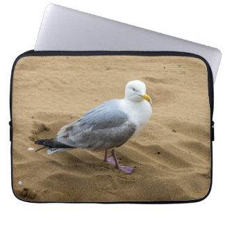 Seagull on a sandy beach laptop sleeve