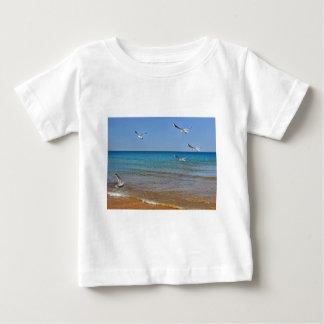 Seagulls on the beach baby T-Shirt