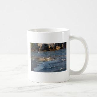 Seagulls on the beach. basic white mug