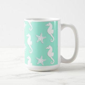 Seahorse & starfish - white on pale aqua coffee mug
