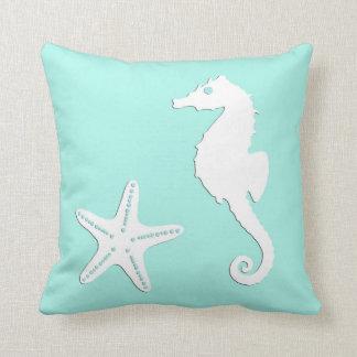 Seahorse & starfish - white on pale aqua throw pillow