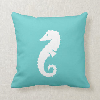SEAHORSE WHITE on teal blue pillow
