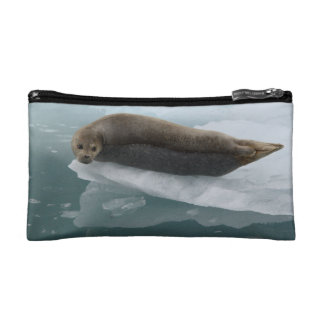 seal resting on ice makeup bag