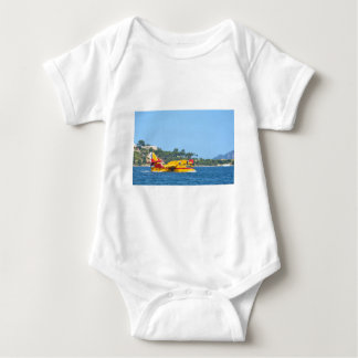 Seaplane taxiing on water. baby bodysuit