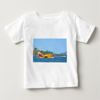 Seaplane taxiing on water. baby T-Shirt