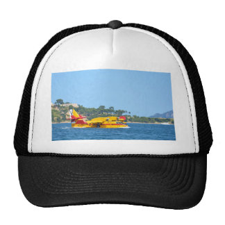Seaplane taxiing on water. cap