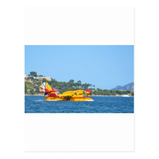 Seaplane taxiing on water. postcard