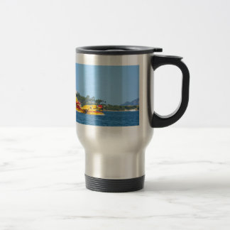 Seaplane taxiing on water. travel mug