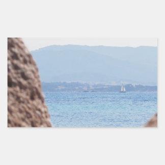 Seascape of Tavolara island on blurred rocks foreg Rectangular Sticker