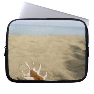 Seashell on sandy beach laptop sleeve