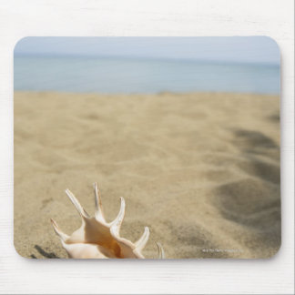 Seashell on sandy beach mouse mat