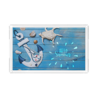 Seashells and anchor on blue wooden surface tray