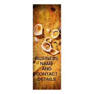 Seashells on sand with texture pack of skinny business cards