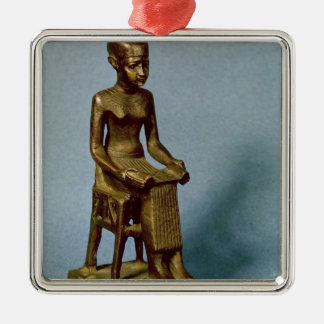 Seated statue of Imhotep  holding an open Christmas Ornament