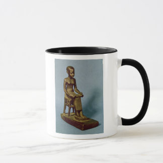 Seated statue of Imhotep  holding an open Mug