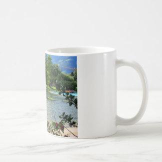 Secret pond on a beautiful sunny day coffee mugs