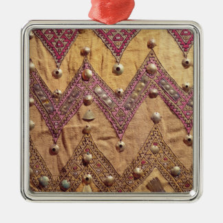 Section of embroidered fabric with gold plaques Silver-Colored square decoration