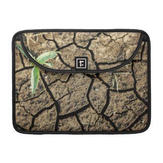 Seedling In Cracked Earth MacBook Pro Sleeves