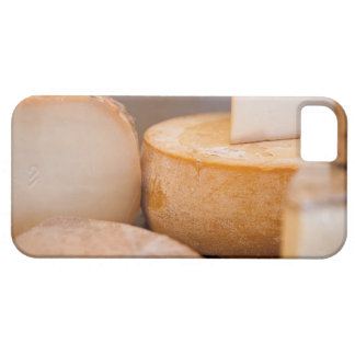 Selective focus photograph of cheeses in cheese case for the iPhone 5
